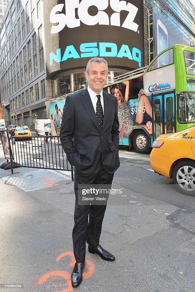 Actor Danny Huston poses outside of NASDAQ at Times Square on June 12, 2013 in New York City.