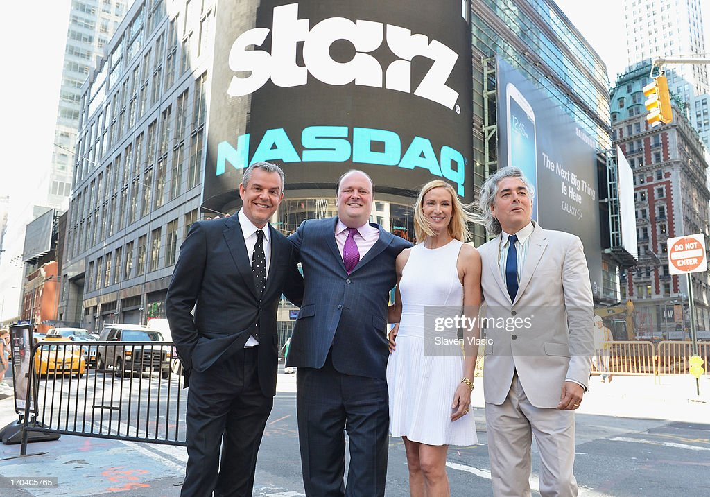 Actor Danny Huston, Vice President, NASDAQ MarketSite David Wicks, actress Kelly Lynch and creator/writer Mitch Glazer pose outside of NASDAQ at Times Square on June 12, 2013 in New York City.