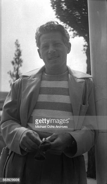 Actor Danny Kaye poses on a street in Los Angeles California