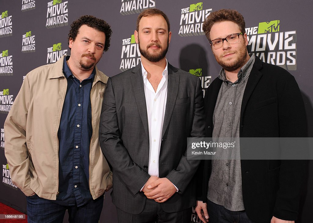 Actor Danny McBride, director <a gi-track='captionPersonalityLinkClicked' href=/galleries/search?phrase=Evan+Goldberg&family=editorial&specificpeople=4455825 ng-click='$event.stopPropagation()'>Evan Goldberg</a> and actor Seth Rogen arrive at the 2013 MTV Movie Awards at Sony Pictures Studios on April 14, 2013 in Culver City, California.
