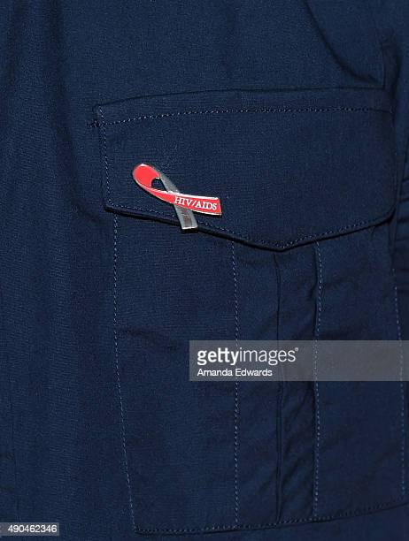 Actor Danny Pintauro badge detail arrives at the premiere party for Fuse's 'Transcendent' at The Village at Ed Gould Plaza on September 28 2015 in...