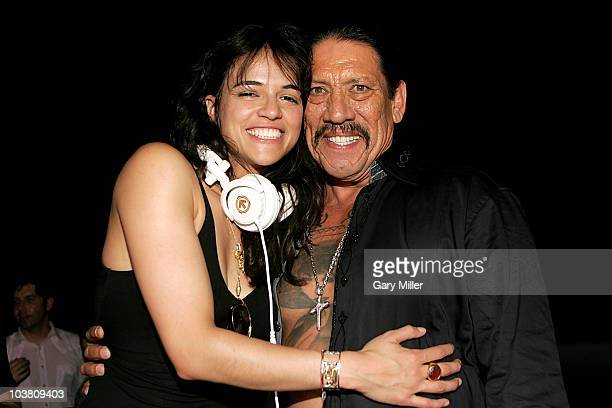 Actor Danny Trejo and Michelle Rodriguez perform as DJ's for the after party of the Machete screening at the Paramount Theater on September 2 2010 in...
