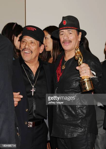 Actor Danny Trejo and musician Carlos Santana pose in the press room at the 2013 NCLA ALMA Awards at Pasadena Civic Auditorium on September 27 2013...