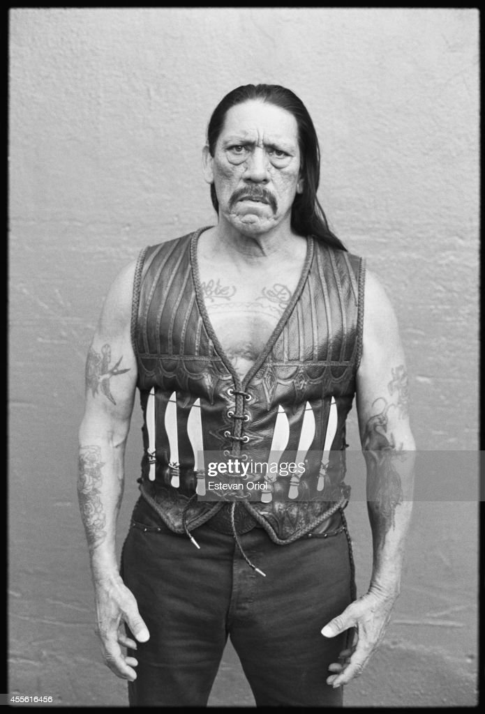 Actor Danny Trejo poses for the Machete movie premiere in an alley behind the Orpheum Theatre Downtown Los Angeles 2010