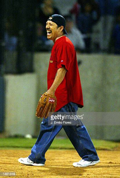 Actor Danny Trejo who plays catcher laughs with the crowd attending a Latino celebrity softball game on October 5 2002 in Los Angeles California The...