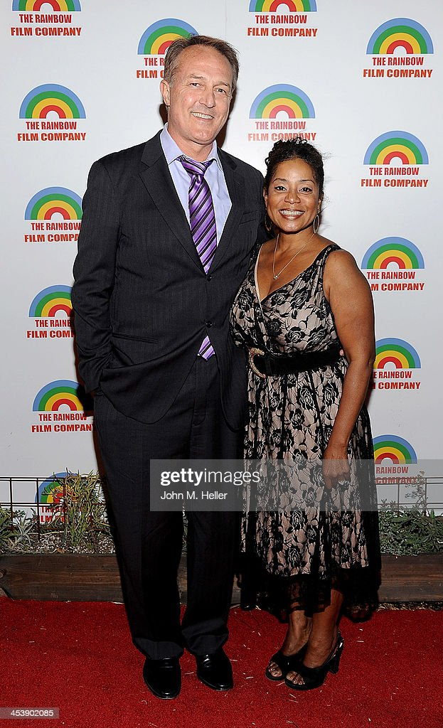 Actor Dar Dixon and producer Donzaleigh Abernathy attend the Project Save Our Surf Holiday Celebration and Fundraiser at the Brakeman Brewery on December 5, 2013 in Los Angeles, California.