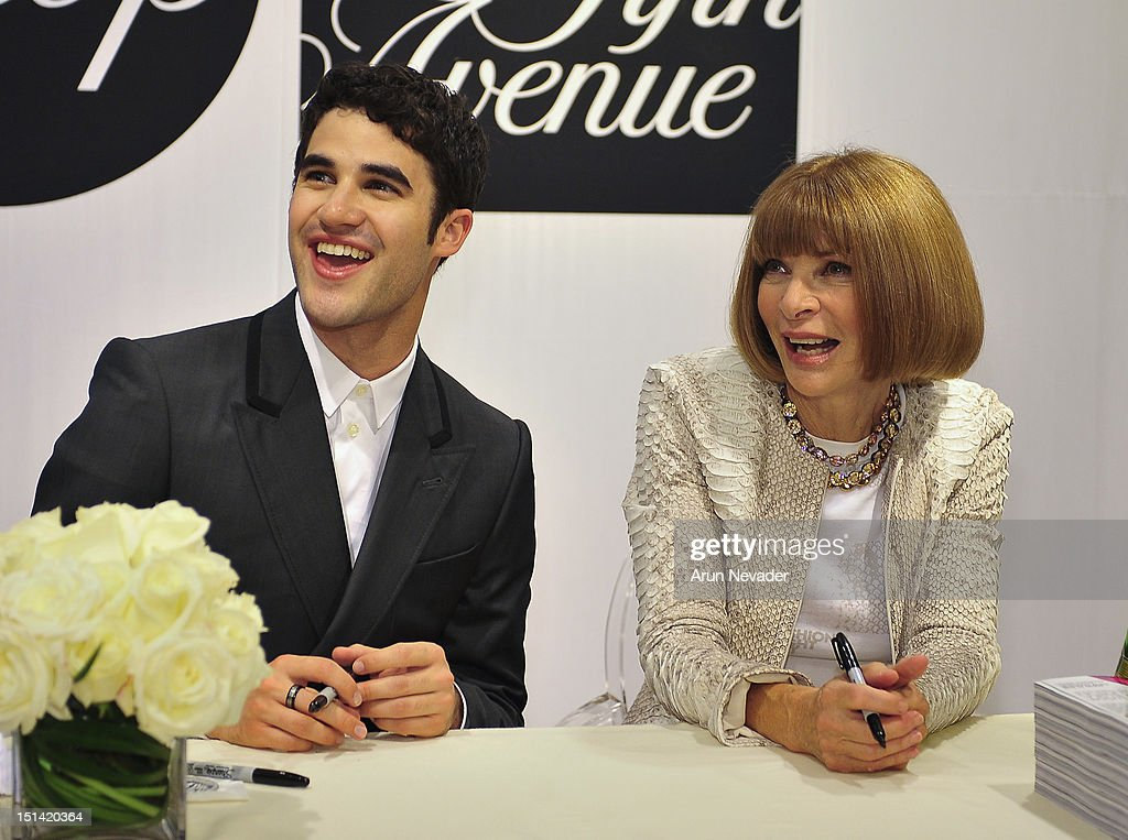 Actor <a gi-track='captionPersonalityLinkClicked' href=/galleries/search?phrase=Darren+Criss&family=editorial&specificpeople=7341435 ng-click='$event.stopPropagation()'>Darren Criss</a> appears with Vogue editor-in-chief <a gi-track='captionPersonalityLinkClicked' href=/galleries/search?phrase=Anna+Wintour&family=editorial&specificpeople=202210 ng-click='$event.stopPropagation()'>Anna Wintour</a> for Fashion's Night Out Vogue magazine signing at Saks Fifth Avenue on September 6, 2012 in New York City.