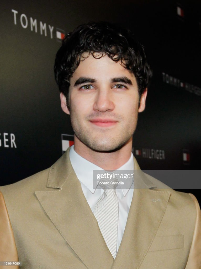 Actor <a gi-track='captionPersonalityLinkClicked' href=/galleries/search?phrase=Darren+Criss&family=editorial&specificpeople=7341435 ng-click='$event.stopPropagation()'>Darren Criss</a> attends Tommy Hilfiger New West Coast Flagship Opening on Robertson Boulevard on February 13, 2013 in West Hollywood, California.