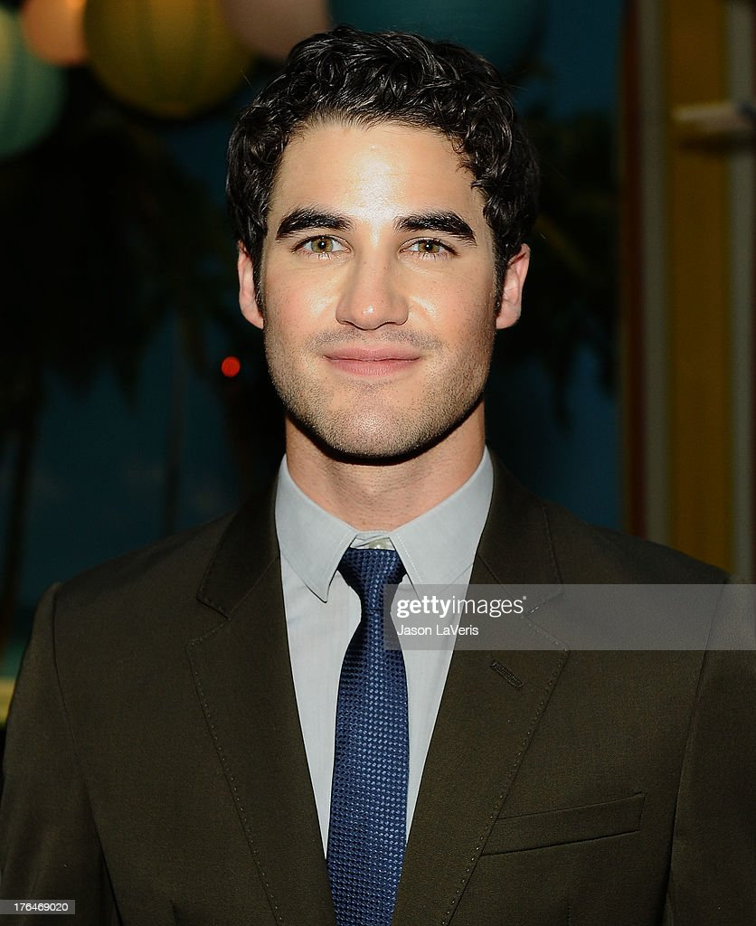 Actor Darren Criss poses in the green room at the 2013 Teen Choice Awards at Gibson Amphitheatre on August 11, 2013 in Universal City, California.