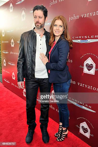 Actor Darren Le Gallo and actress Amy Adams arrive at the John Varvatos 11th Annual Stuart House Benefit at John Varvatos Boutique on April 13 2014...
