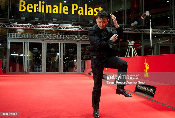 Actor Darren Leung performs a martial arts kick on the red carpet after the premiere of 'The Grandmaster' during the 63rd Berlinale International...