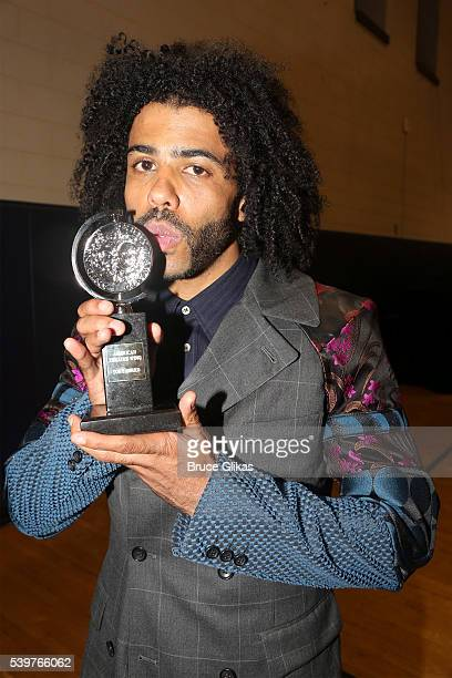 Actor Daveed Diggs poses with his award for Best Performance by an Actor in a Featured Role in a Musical for 'Hamilton' during the 70th Annual Tony...