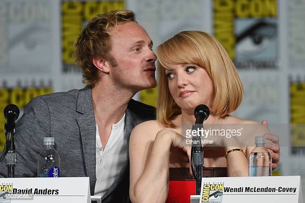Actor David Anders kisses actress Wendi McLendonCovey at the TV Guide Magazine Fan Favorites panel during ComicCon International 2015 at the San...