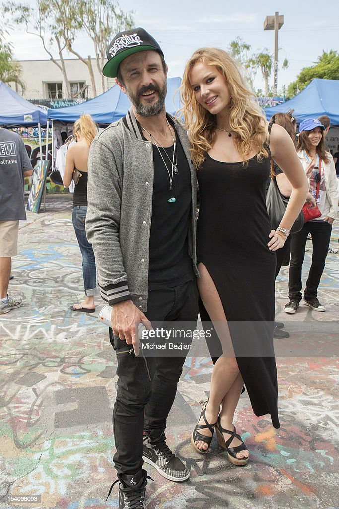 Actor <a gi-track='captionPersonalityLinkClicked' href=/galleries/search?phrase=David+Arquette&family=editorial&specificpeople=201740 ng-click='$event.stopPropagation()'>David Arquette</a> and Actress Charlotte Kirk attend <a gi-track='captionPersonalityLinkClicked' href=/galleries/search?phrase=David+Arquette&family=editorial&specificpeople=201740 ng-click='$event.stopPropagation()'>David Arquette</a>'s Piece Fest - a music and street festival to benefit Pico Union Housing Corp. and Graff Lab at The Graff Lab on October 13, 2012 in Los Angeles, California.