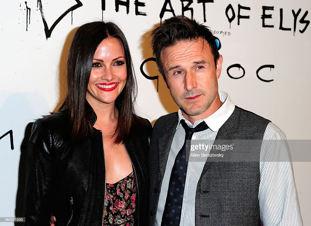 Actor David Arquette (R) and Christina McLarty attend The Art of Elysium's 6th annual Pieces of Heaven charity art auction presented by Ciroc Ultra Premium Vodka at Ace Museum on February 20, 2013 in Los Angeles, California.