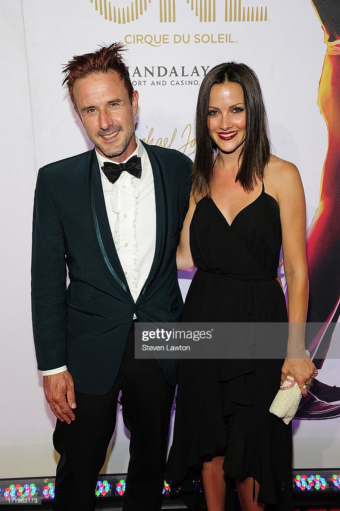 Actor David Arquette and television personality Christina McLarty arrive at the world premiere of 'Michael Jackson ONE by Cirque du Soleil' at...