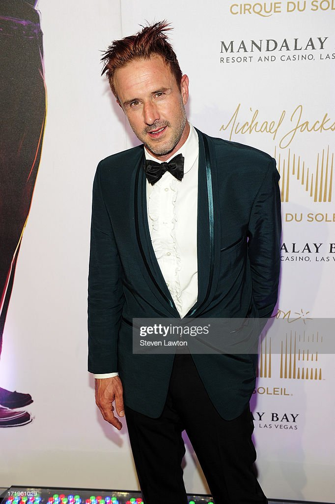 Actor <a gi-track='captionPersonalityLinkClicked' href=/galleries/search?phrase=David+Arquette&family=editorial&specificpeople=201740 ng-click='$event.stopPropagation()'>David Arquette</a> arrives at the world premiere of 'Michael Jackson ONE by Cirque du Soleil' at THEhotel at Mandalay Bay on June 29, 2013 in Las Vegas, Nevada.