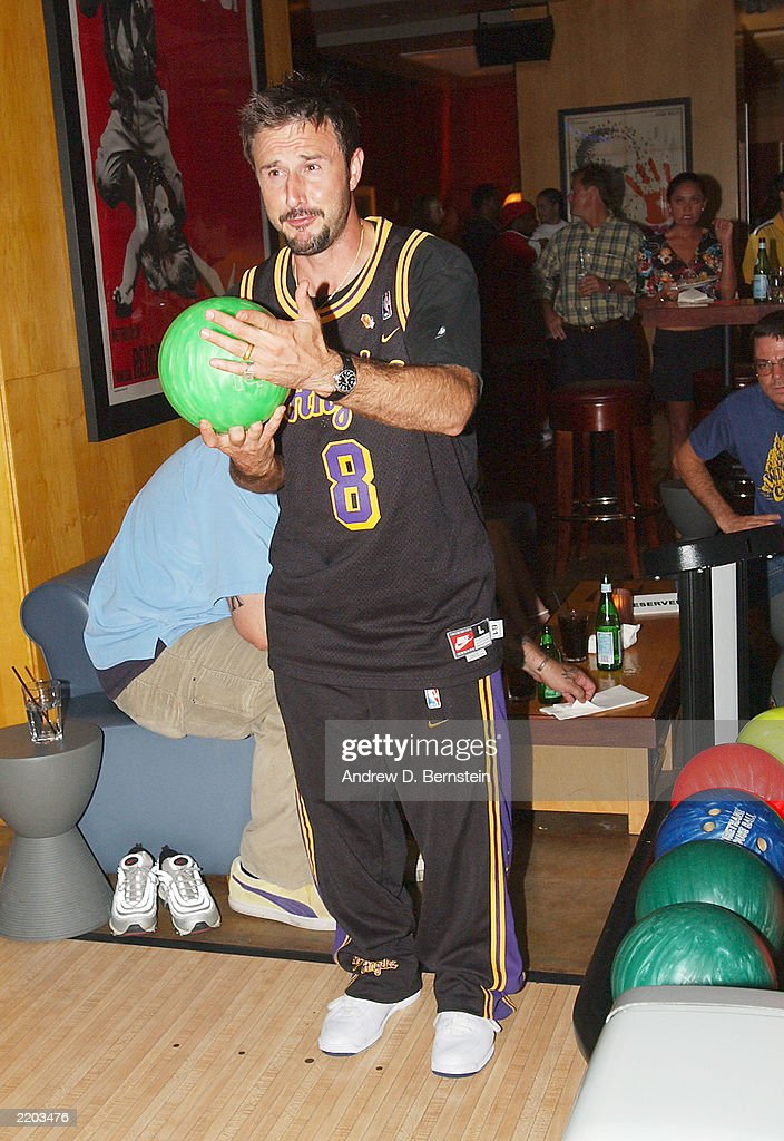 Actor David Arquette gets ready to bowl at a party held for Gary Payton and Karl Malone celebrating both Los Angeles Lakers players' birthdays at the Lucky Strike on July 24, 2003 in Los Angeles, California.