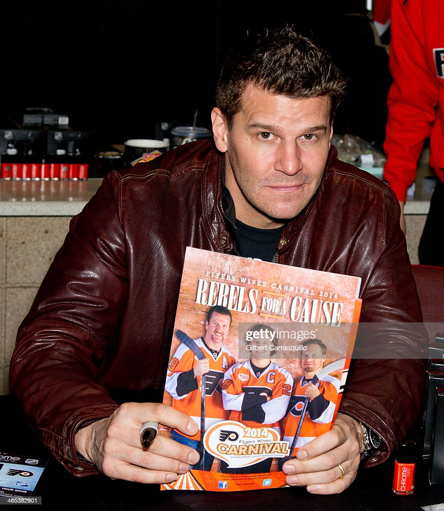 Actor <a gi-track='captionPersonalityLinkClicked' href=/galleries/search?phrase=David+Boreanaz&family=editorial&specificpeople=214055 ng-click='$event.stopPropagation()'>David Boreanaz</a> promotes Chrome Girl NHL Philadelphia Flyers team colors nail laquer during the welcoming of <a gi-track='captionPersonalityLinkClicked' href=/galleries/search?phrase=David+Boreanaz&family=editorial&specificpeople=214055 ng-click='$event.stopPropagation()'>David Boreanaz</a> as a celebrity co-chair to the 37th Flyers Wives Carnival at Wells Fargo Center on January 26, 2014 in Philadelphia, Pennsylvania.