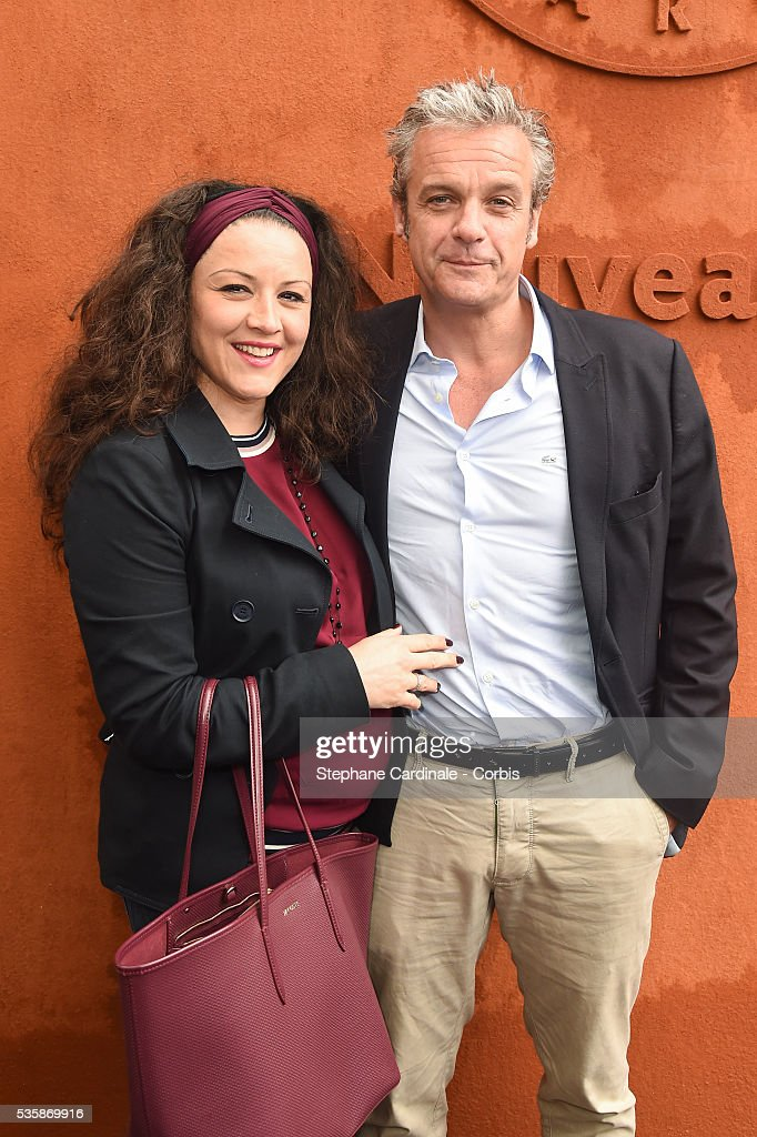 Actor David Brecourt (R) and his pregnant companion Alexandra Sarramona (L) attend day nine of the 2016 French Open at Roland Garros on May 30, 2016 in Paris, France.