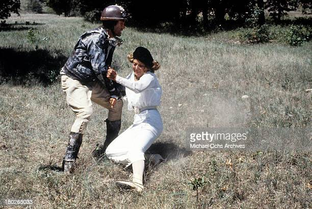 Actor David Carradine and actress Brenda Vaccaro on set of the Universal Studios movie ' Fast Charlie the Moonbeam Rider' in 1979