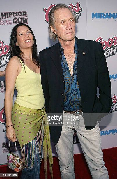 Actor David Carradine and Annie Bierman attend the film premiere of 'Hero' at the Arclight Theater on August 17 2004 in Hollywood California The film...