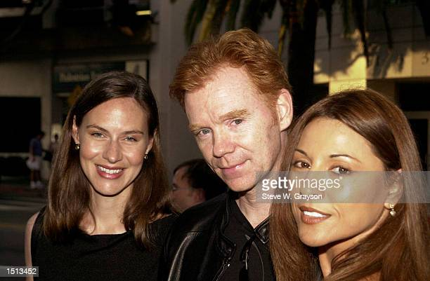 Actor David Caruso and wife Margaret left and friend Amparo Grisales pose for photographers at the premiere of 'Steal This Movie' at Lammele's...