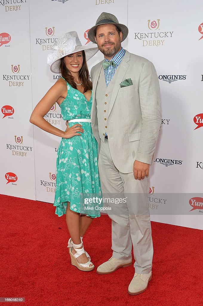 Actor David Denman (R) and Mercedes Masohn celebrate the 139th Kentucky Derby with Moet & Chandon at Churchill Downs on May 4, 2013 in Louisville, Kentucky.