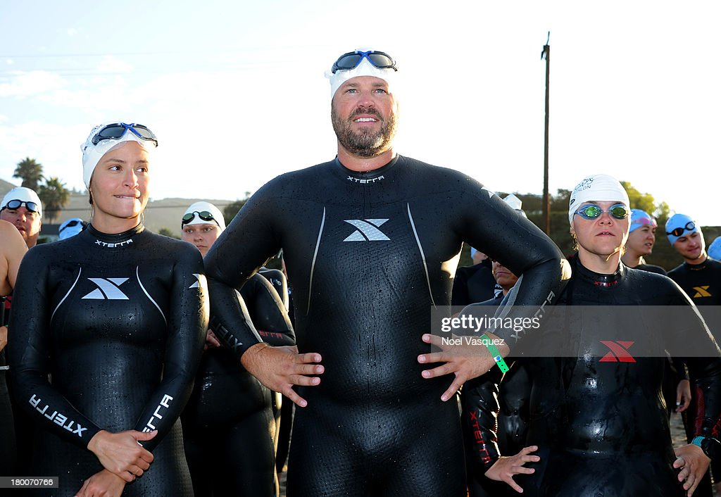 Actor <a gi-track='captionPersonalityLinkClicked' href=/galleries/search?phrase=David+Denman&family=editorial&specificpeople=851215 ng-click='$event.stopPropagation()'>David Denman</a> (C) attends the Nautica Malibu Triathlon presented by Equinox on September 8, 2013 in Malibu, California.
