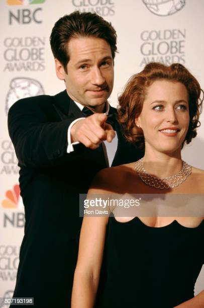 Actor David Duchovny and actress Gillian Anderson attend the 55th Annual Golden Globe Awards on January 18 1998 at the Beverly Hilton Hotel in...