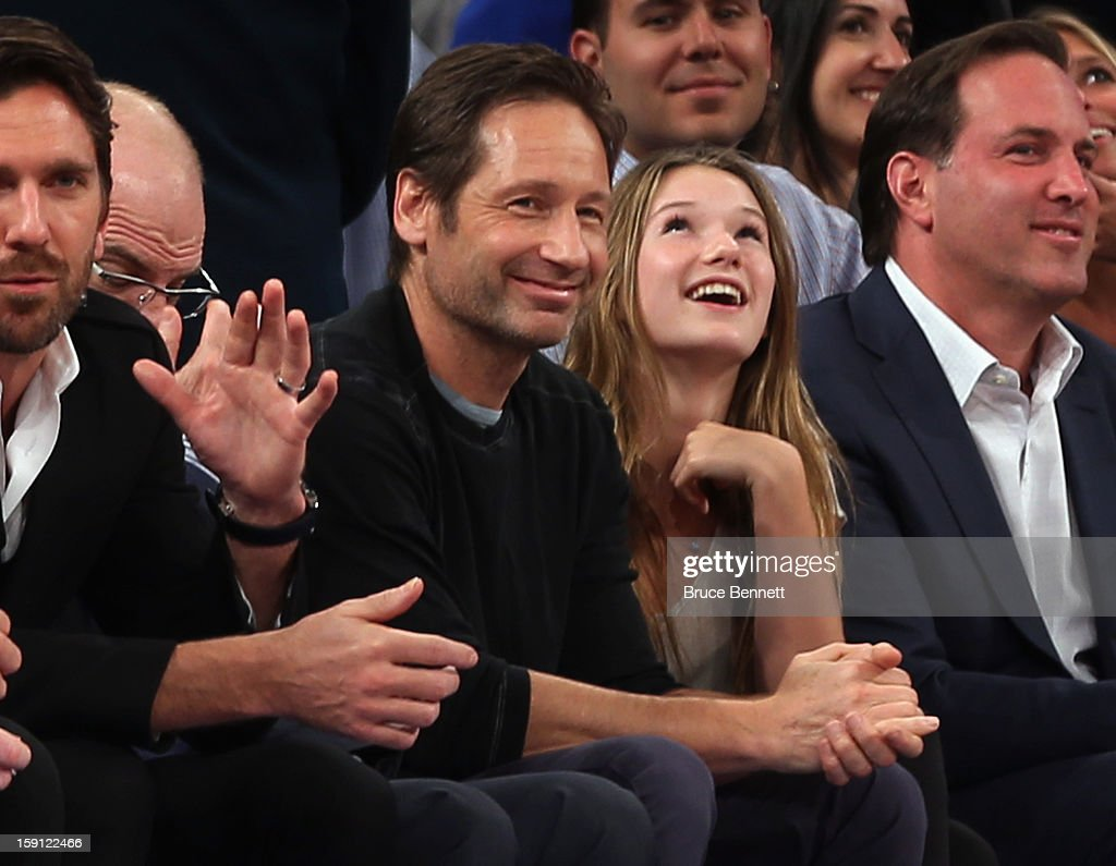 Actor David Duchovny and his daughter Madeline take in the game between the New York Knicks and the Boston Celtics at Madison Square Garden on January 7, 2013 in New York City.