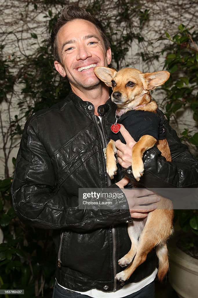 Actor <a gi-track='captionPersonalityLinkClicked' href=/galleries/search?phrase=David+Faustino&family=editorial&specificpeople=226901 ng-click='$event.stopPropagation()'>David Faustino</a> poses with a dog wearing Lyric Culture for PetSmart at Much Love Animal Rescue's makeovers for mutts at Peninsula Hotel on March 14, 2013 in Beverly Hills, California.
