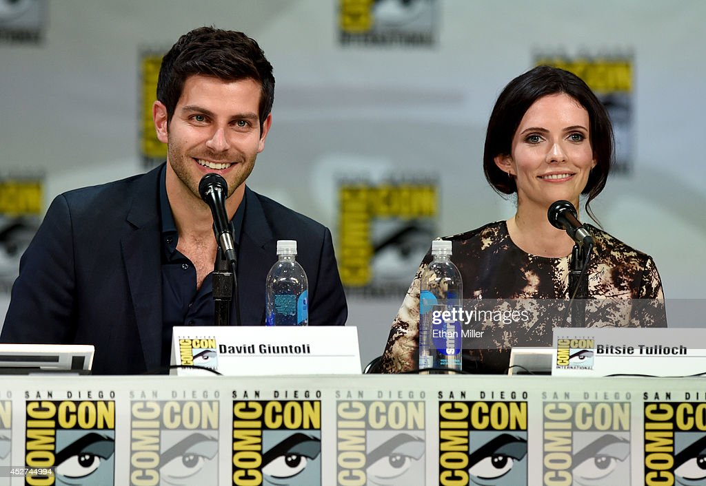 Actor <a gi-track='captionPersonalityLinkClicked' href=/galleries/search?phrase=David+Giuntoli&family=editorial&specificpeople=8011911 ng-click='$event.stopPropagation()'>David Giuntoli</a> (L) and actress <a gi-track='captionPersonalityLinkClicked' href=/galleries/search?phrase=Bitsie+Tulloch&family=editorial&specificpeople=4616199 ng-click='$event.stopPropagation()'>Bitsie Tulloch</a> attend the 'Grimm' season four panel during Comic-Con International 2014 at the San Diego Convention Center on July 26, 2014 in San Diego, California.