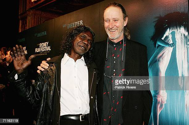 Actor David Gulpilil and film director Rolf de Heer attend the Sydney Film Festival Opening Night at the State Theatre June 9 2006 in Sydney Australia