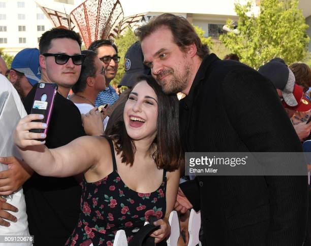 Actor David Harbour poses for a photo with a fan as he attends the 2017 NHL Awards at TMobile Arena on June 21 2017 in Las Vegas Nevada