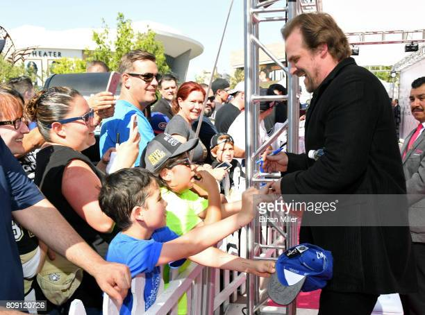 Actor David Harbour signs autographs for fans as he attends the 2017 NHL Awards at TMobile Arena on June 21 2017 in Las Vegas Nevada