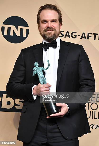 Actor David Harbour winner of the Outstanding Ensemble in a Drama Series award for 'Stranger Things' poses in the press room during the 23rd Annual...