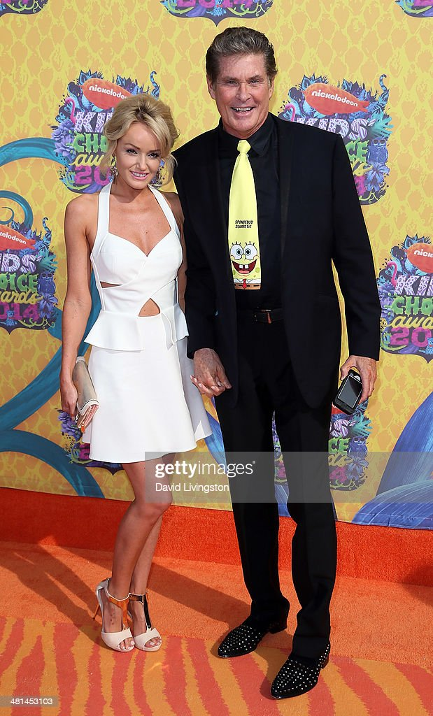 Actor David Hasselhoff (R) and Hayley Roberts attend Nickelodeon's 27th Annual Kids' Choice Awards at USC Galen Center on March 29, 2014 in Los Angeles, California.
