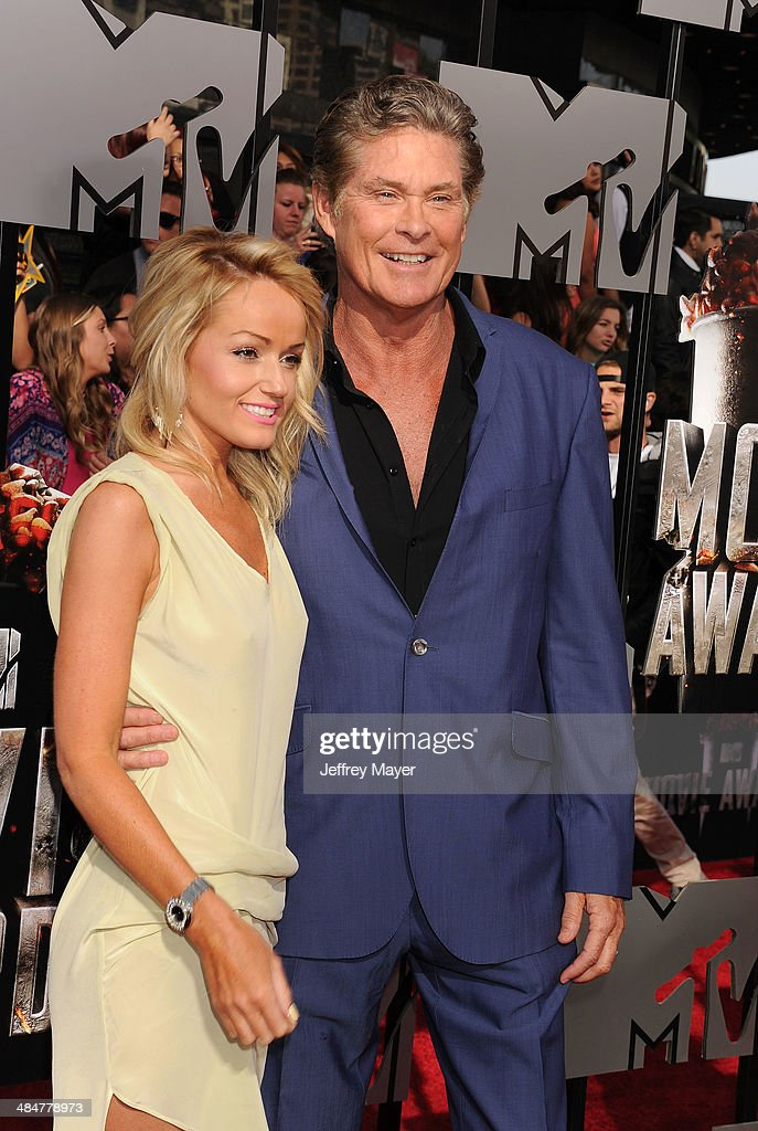 Actor David Hasselhoff (R) and <a gi-track='captionPersonalityLinkClicked' href=/galleries/search?phrase=Hayley+Roberts&family=editorial&specificpeople=7627544 ng-click='$event.stopPropagation()'>Hayley Roberts</a> attend the 2014 MTV Movie Awards at Nokia Theatre L.A. Live on April 13, 2014 in Los Angeles, California.