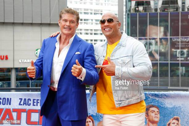 US actor David Hasselhoff and US Wrestler and actor Dwayne Johnson attend the 'Baywatch' Photo Call in Berlin on May 30 2017 in Berlin Germany