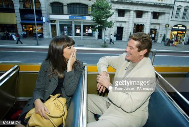US actor David Hasselhoff joins TV presenter Claudia Winkleman on an open top bus through Holborn in central London after leaving the preshow party...