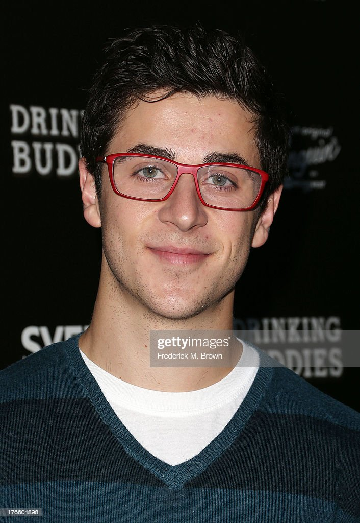 Actor <a gi-track='captionPersonalityLinkClicked' href=/galleries/search?phrase=David+Henrie&family=editorial&specificpeople=2960032 ng-click='$event.stopPropagation()'>David Henrie</a> attends the screening of Magnolia Pictures' 'Drinking Buddies' at the ArcLight Cinemas on August 15, 2013 in Hollywood, California.