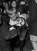 Actor David McCallum who plays Ilya Kuryakin in the TV series 'The Man from UNCLE' is mobbed by fans at the Empire Cinema Leicester Square London