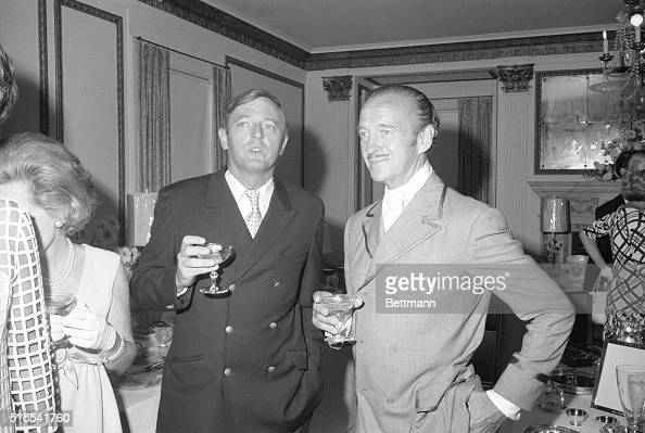 Actor David Niven chats with author and magazine publisher William Buckley during a reception following the wedding of his son James Niven to...