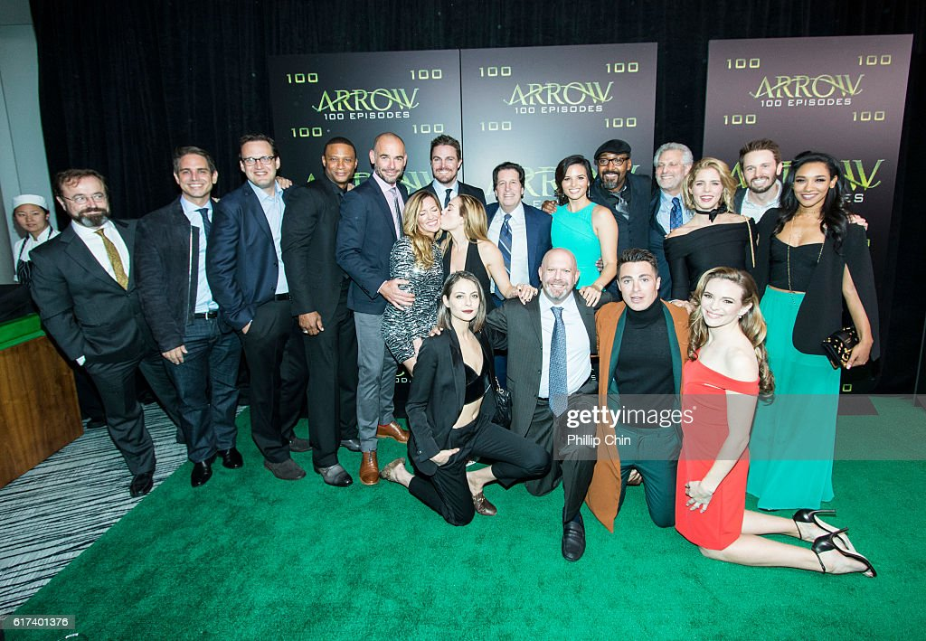Actor David Nykl, executive producers Greg Berlanti and Andrew Kreisberg, actors David Ramsey, Paul Blackthorne, Katie Cassidy, Willa Holland, Stephen Amell, Caity Lotz, President and Chief Content Officer Warner Bros Television Group Peter Roth, executive producer Marc Guggenheim, actors Katrina Law, Jesse L. Martin, Colton Haynes, President of The CW Mark Pedowitz, and actors Emily Bett Rickards, Danielle Panabaker, Tyler Ritter and Candice Patton arrive on the green carpet for the celebration of the 100th Episode of CW's 'Arrow' at the Fairmont Pacific Rim Hotel on October 22, 2016 in Vancouver, BC, Canada.