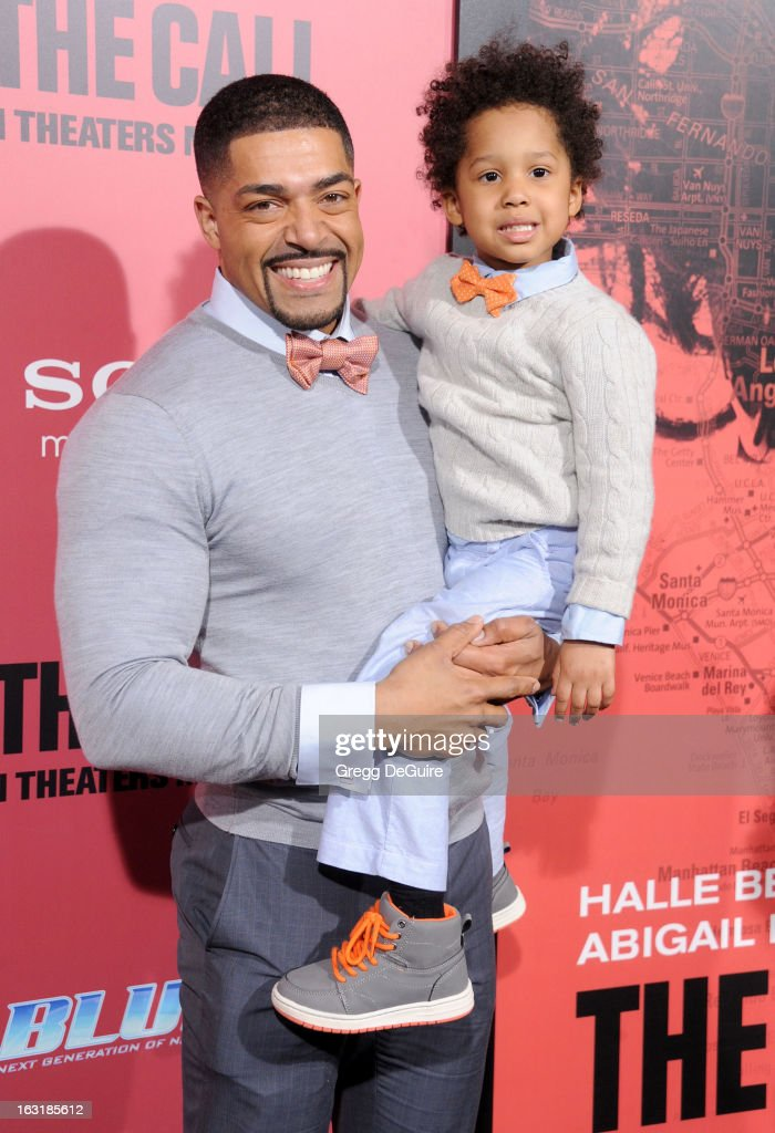 Actor David Otunga and son David Otunga Jr arrive at the Los Angeles premiere of 'The Call' at ArcLight Hollywood on March 5, 2013 in Hollywood, California.
