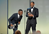 Actor David Oyelowo accepts the award for Outstanding Actor in a Motion Picture for 'Selma' from actor Will Smith onstage at the 46th Annual NAACP...