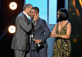 Actor David Oyelowo accepts the award for Outstanding Actor in a Motion Picture for 'Selma' from actors Laurence Fishburne and Angela Bassett onstage...