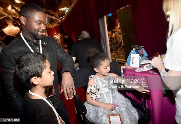 Actor David Oyelowo Caleb Oyelowo and Zoe Oyelowo arrive for the world premiere of Disney's liveaction 'Beauty and the Beast' at the El Capitan...