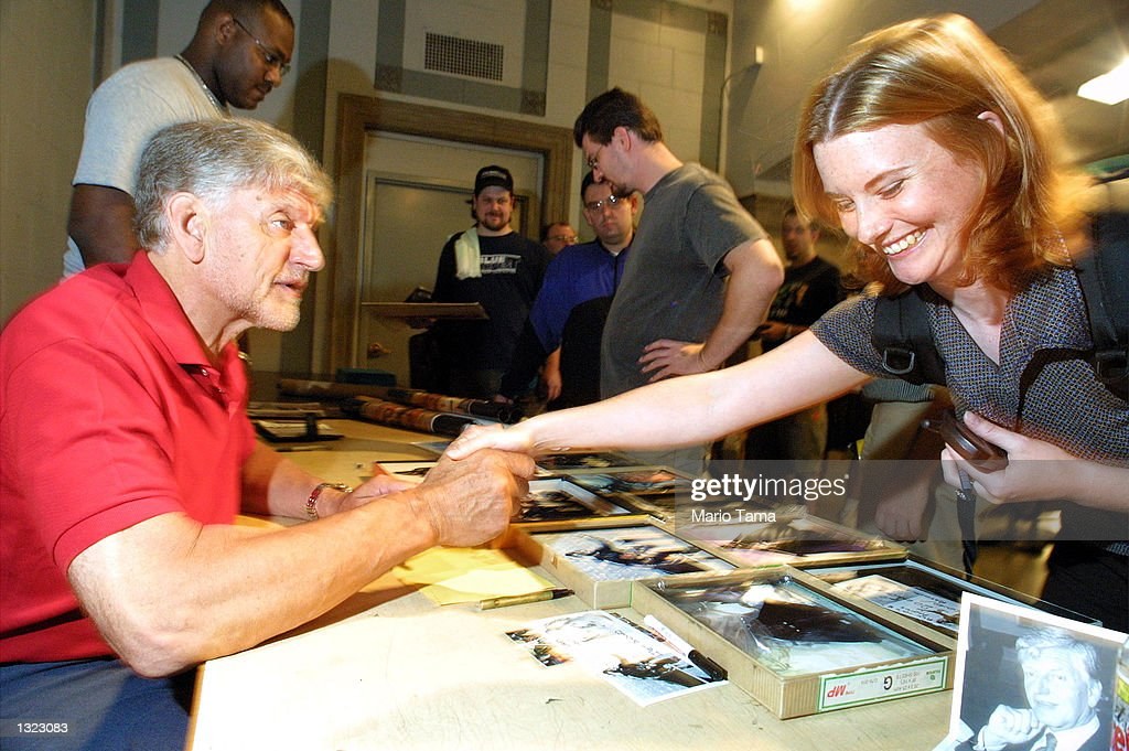 Actor David Prowse, the man who played the physical role of 'Darth Vader' in the film 'Star Wars,' greets a fan July 6, 2001 at the Big Apple Comic Book, Art, and Toy Show in New York City.